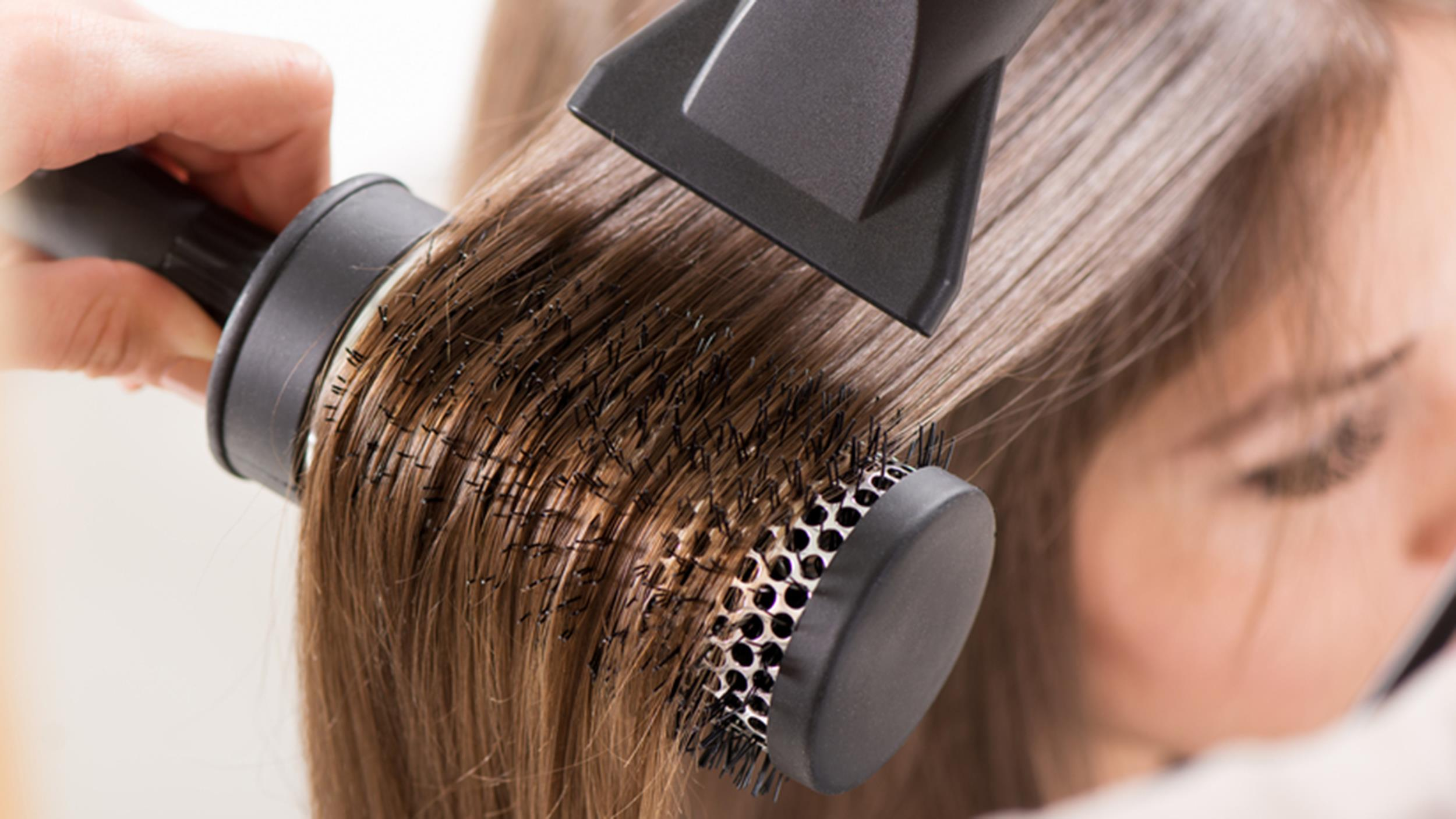 blowdrying your hair image