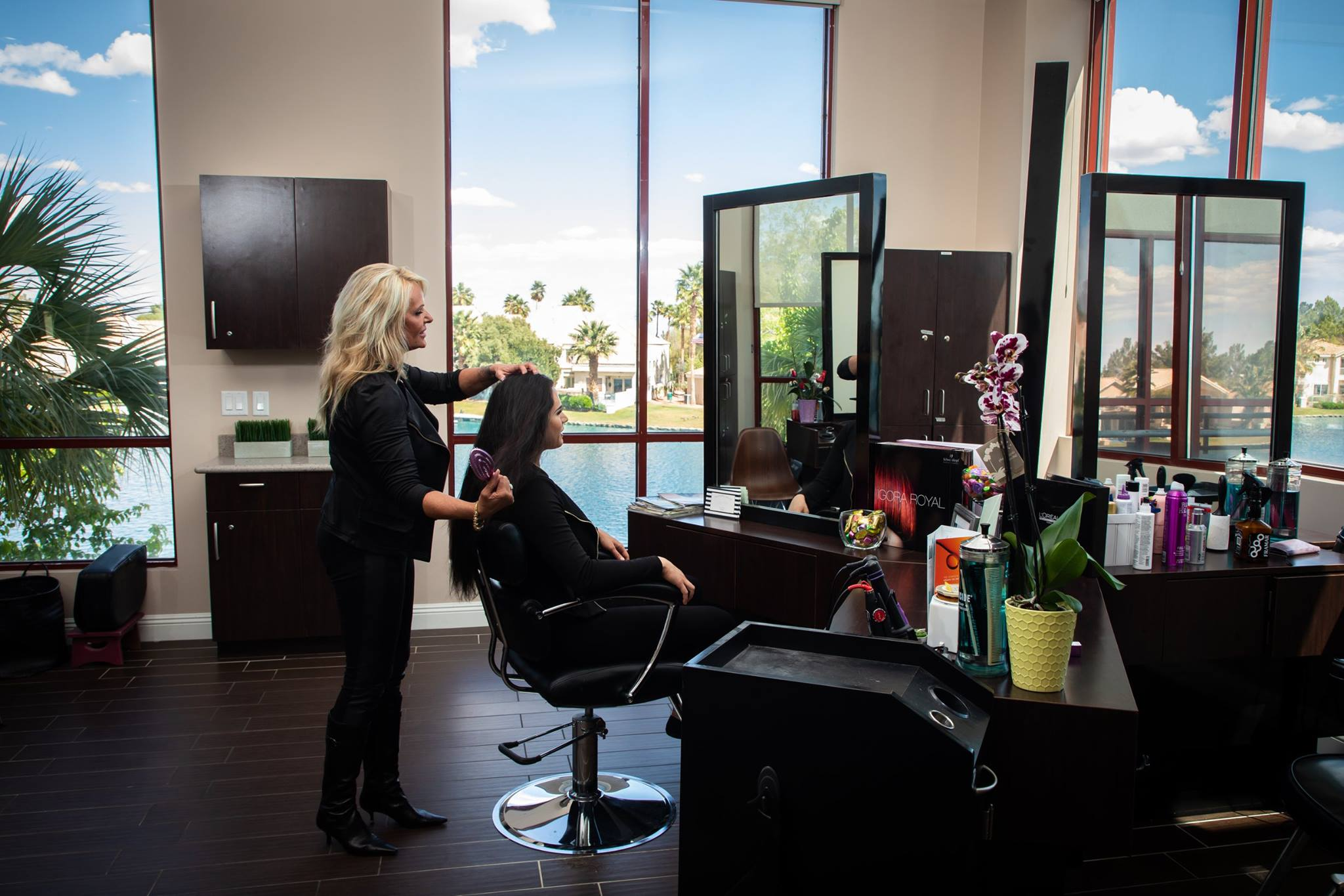 Stylists cutting hair at the Salon at Lakeside with the lake view in the background