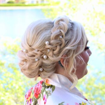 Side view of daughter on her wedding day at Lakeside Village with braided hair by The Salon at Lakeside