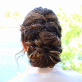 Desert Shores wedding bride with back view of dark hair braided by staff at The Salon at Lakeside
